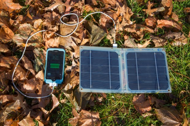 Suntactics sCharger-5 solar panel charging an iPhone