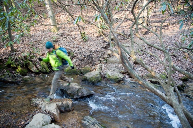 Anna crossing a creek on the Appalachian Trail