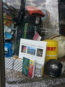 Our PCT book in the window of the Roads, Rivers, and Trails store