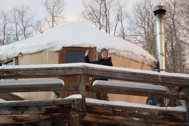 Waving from yurt deck