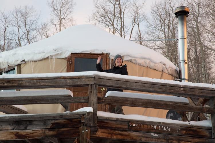Waving from yurt deck