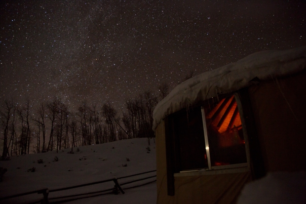 Milky Way and fire glow from yurt