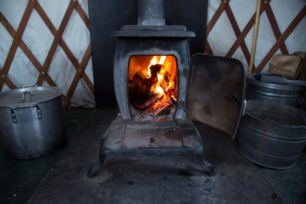 Wood stove in yurt