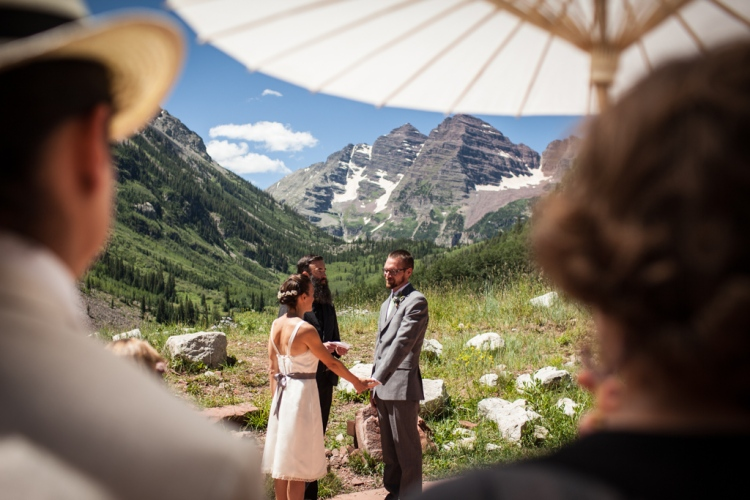 Exchanging vows in front of Maroon Bells (photo by Kent Meireis)