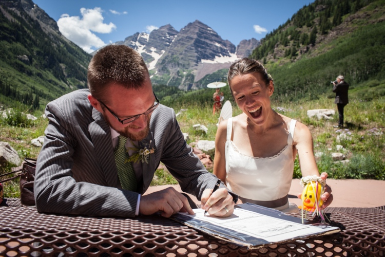 Cheep Cheep cheers us on as we sign the marriage license (photo by Kent Meireis)
